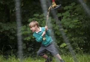 Boy pulling zip wire along