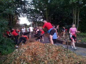Runners from the Good Gym get to work  clearing a pathway